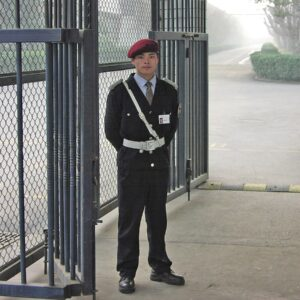 1200px-Private_factory_guard